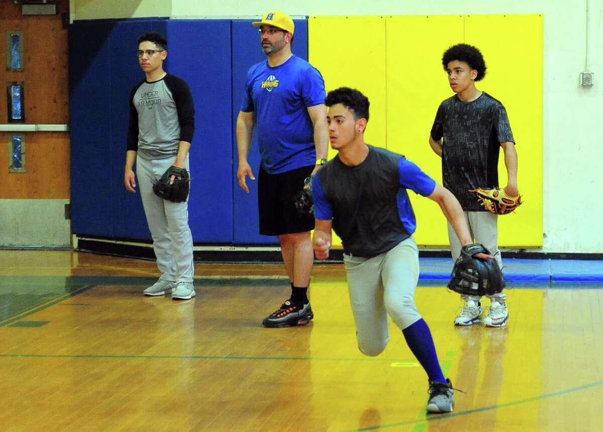 Junior shortstop Jonathon Lopez practices with his Harding teammates this week.