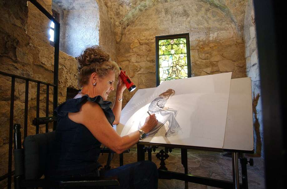 Artist Sherry Steele works on a portrait of Susanna Dickinson, a 22-year-old survivor of the Battle of the Alamo, on Aug 8, 2003, at the Alamo Shrine. Steele had been commissioned to paint the piece to be auctioned off to benefit the Daughters of the Republic of Texas. Photo: Billy Calzada / San Antonio Express-News