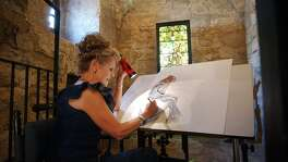 Artist Sherry Steele works on a portrait of Susanna Dickinson, a 22-year-old survivor of the Battle of the Alamo, on Aug 8, 2003, at the Alamo Shrine. Steele had been commissioned to paint the piece to be auctioned off to benefit the Daughters of the Republic of Texas.