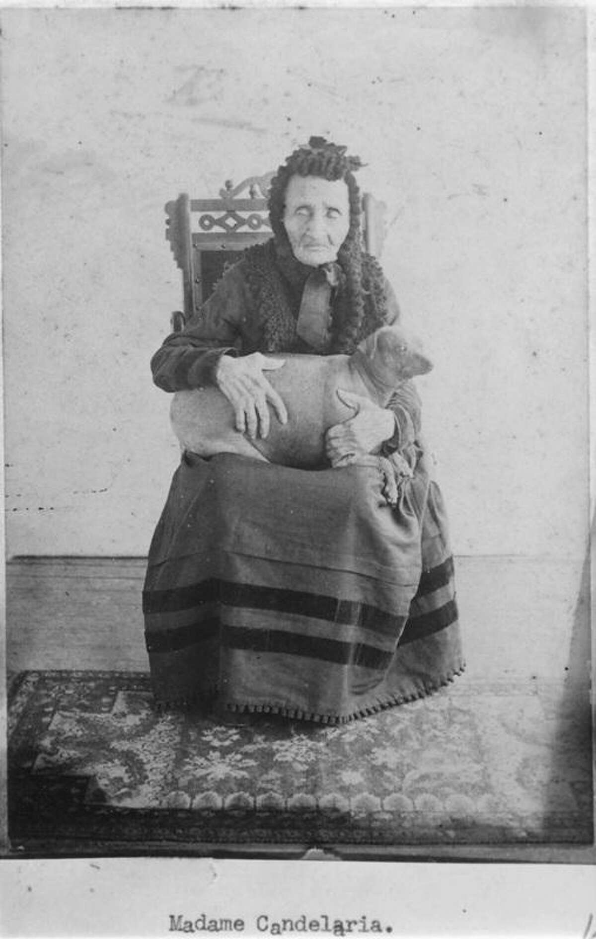 Maria Andrea Castañon Villanueva, also known as Madam Candelaria In this undated photo, Madam Candelaria poses with her dog. The woman, who claimed to have been nursing the ailing Jim Bowie when he was killed by Santa Anna's army at the Battle of the Alamo, lived to be 113. She said her dog slept on her feet and kept her rheumatism at bay.