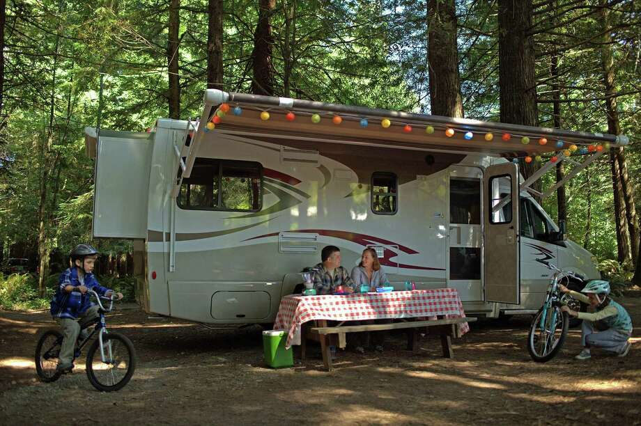 Millions of recreational vehicles crisscross the country each year. There are many different types of vehicles to enjoy, including motor homes, such as this Type C, which teams a standard car with a camper. Photo: RVIA / Contributed Photo / Connecticut Post contributed