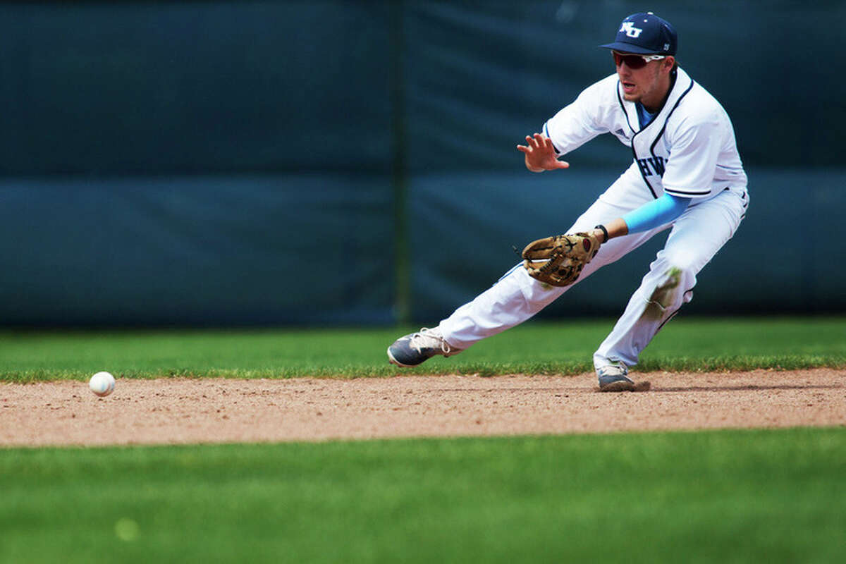 THEOPHIL SYSLO | For the Daily News Northwood University's Kyle Ziegler fields a ground ball in a game against Kentucky Wesleyan at Northwood on Thursday.
