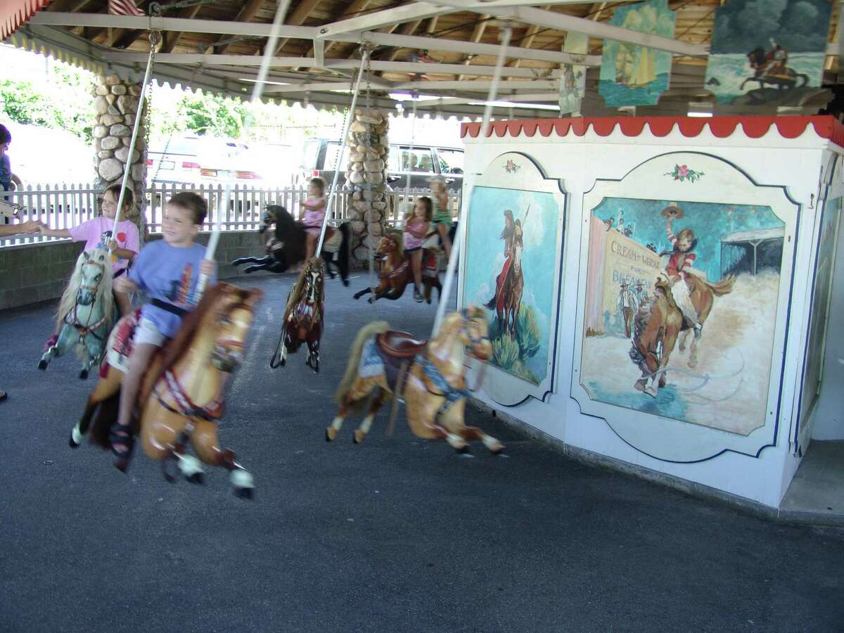 Watch Hill's Flying Horse Carousel.