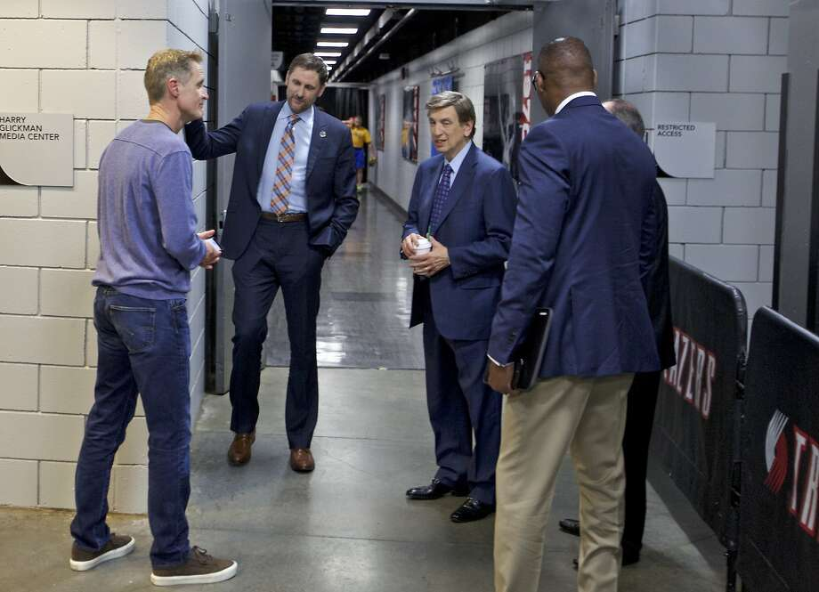 Golden State Warriors head coach Steve Kerr, left, talks with TNT broadcasters Brent Barry, center, and Marv Albert before Game 4 of an NBA basketball first-round playoff series Monday, April 24, 2017, in Portland, Ore. Kerr is not coaching the game due to illness, but is in the arena. (AP Photo/Craig Mitchelldyer) Photo: Craig Mitchelldyer, Craig Mitchelldyer, Associated Press