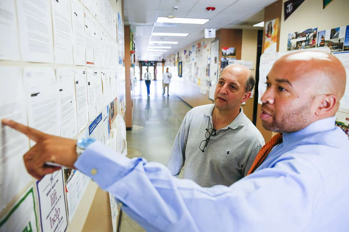 Former Houston Rockets head coach and Pro-Vision Charter School board member Jeff Van Gundy, left, looks at college acceptance letters with executive principal Andre Credit as they take a tour of the school Thursday, March 2, 2017 in Houston. ( Michael Ciaglo / Houston Chronicle )