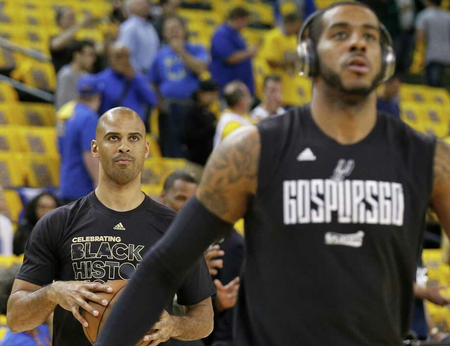 Spurs assistant coach Ime Udoka works out with LaMarcus Aldridge before Game 2 of the Western Conference finals held on May 16, 2017 at Oracle Arena in Oakland, Calif. Photo: Edward A. Ornelas /San Antonio Express-News / © 2017 San Antonio Express-News