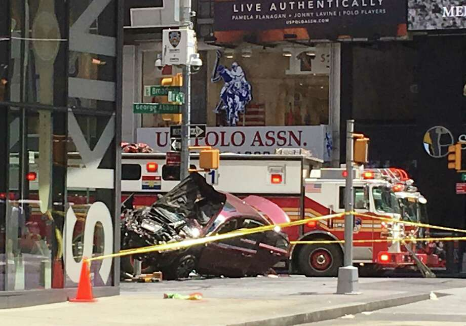 A smashed car sits on the corner of Broadway and 45th Street in New York's Times Square after driving through a crowd of pedestrians Thursday, May 18, 2017. (AP Photo/Seth Wenig) Photo: Seth Wenig, STF / AP