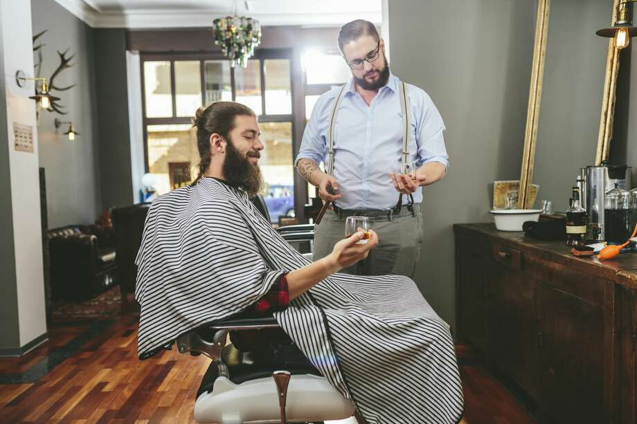 You get your hair cut at a barbershop where they serve cocktails. Photo: Westend61/Getty Images/Westend61