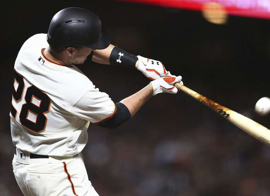 Buster Posey connects for a home run against the Dodgers on Monday night, one of six he's hit this month. Photo: Scott Strazzante / Scott Strazzante / The Chronicle / **MANDATORY CREDIT FOR PHOTOG AND SF CHRONICLE/NO SALES/MAGS OUT/TV