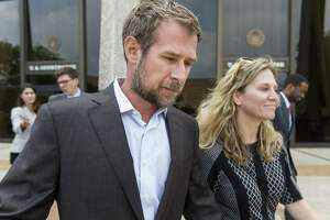 Lubbock businessman Vernon C. Farthing III leaves the federal courthouse Thursday, May 18, 2017 in San Antonio, Texas with his wife, Aurora, after making his first court appearance on conspiracy to commit bribery and conspiracy to commit money laundering charges.