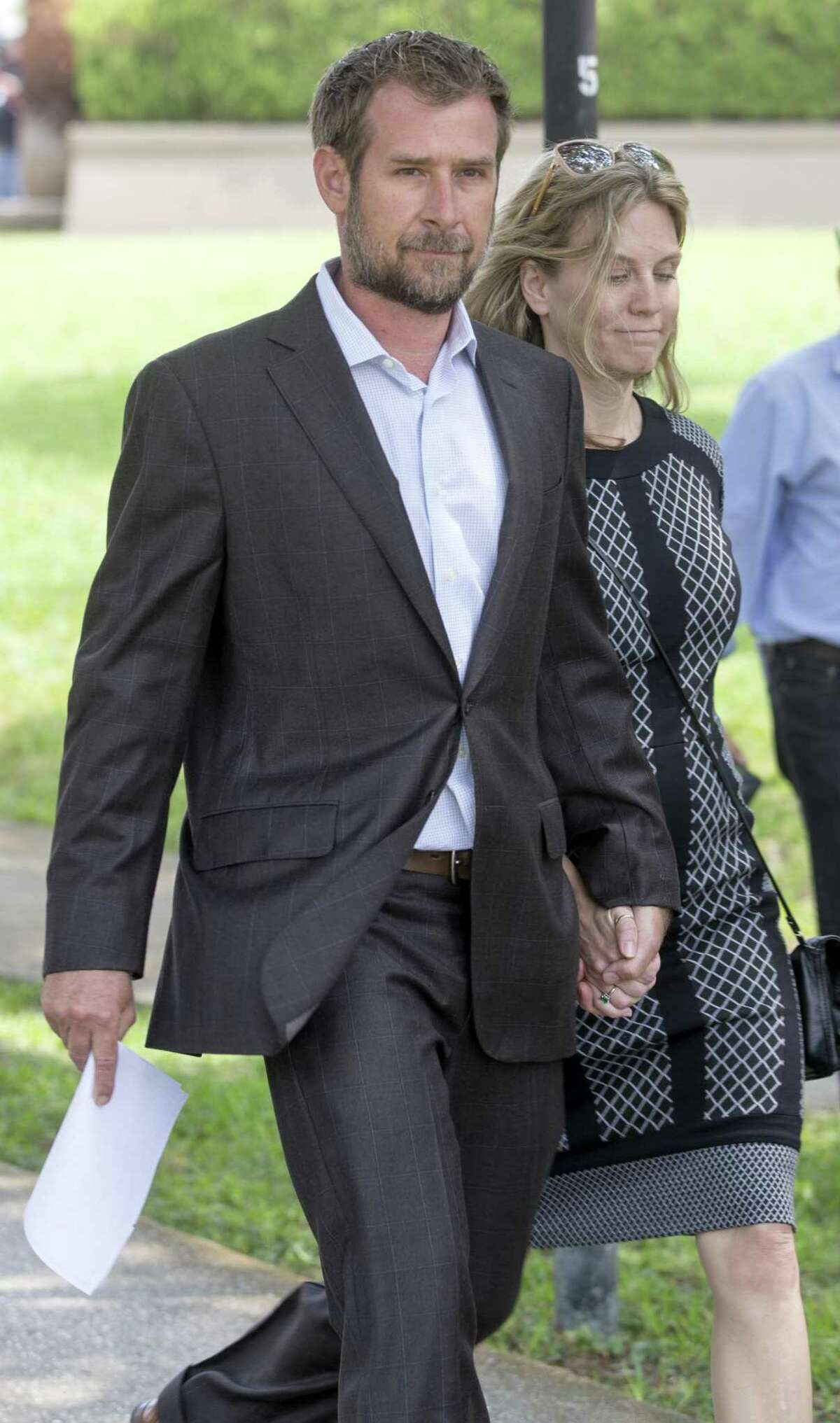 Lawyers for Lubbock businessman Vernon C. Farthing, state Sen. Carlos Uresti's co-defendant, requested a more than five month delay in the trial. The two men will now stand trial beginning Oct. 22. Farthing is seen with his wife, Aurora, leaving the San Antonio federal courthouse in May.
