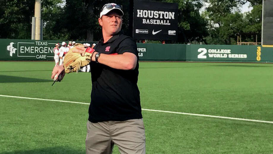 UH football coach Major Applewhite throws the first pitch before the Cougars' game against Cincinnati on Thursday, May 18, 2017. Photo: Joseph Duarte