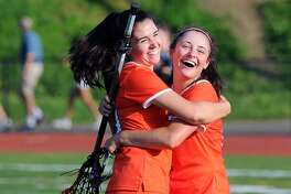 R idgefield's K aitly n Mc Mullan, right, celebrates her game-winning overtime goal with teammate Julia Realander at the end of their FCIAC playoff game Thursday in  Greenwich.