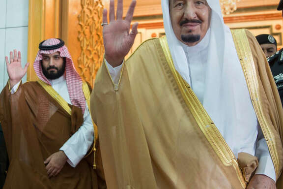 FILE -- In this April 5, 2017 file photo, released by the Saudi Press Agency, SPA, Saudi King Salman, right, and Defense Minister and Deputy Crown Prince Mohammed bin Salman wave as they leave the hall after talks with the British prime minister, in Riyadh, Saudi Arabia. Saudi Arabia is making every effort to dazzle and impress President Donald Trump on his first overseas trip. The kingdom wants to seize on the historic visit to cement itself as a major player on the world stage and shove aside rival Iran as a rogue state on the fringes of the Muslim world. (Saudi Press Agency via AP, File)