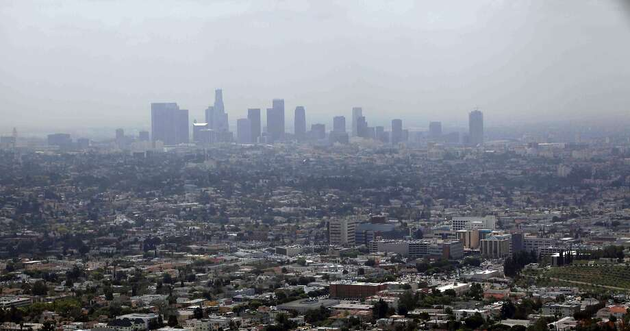 Smog covers downtown Los Angeles in 2009, three years before California passed its cap-and-trade law. Photo: Nick Ut, Associated Press