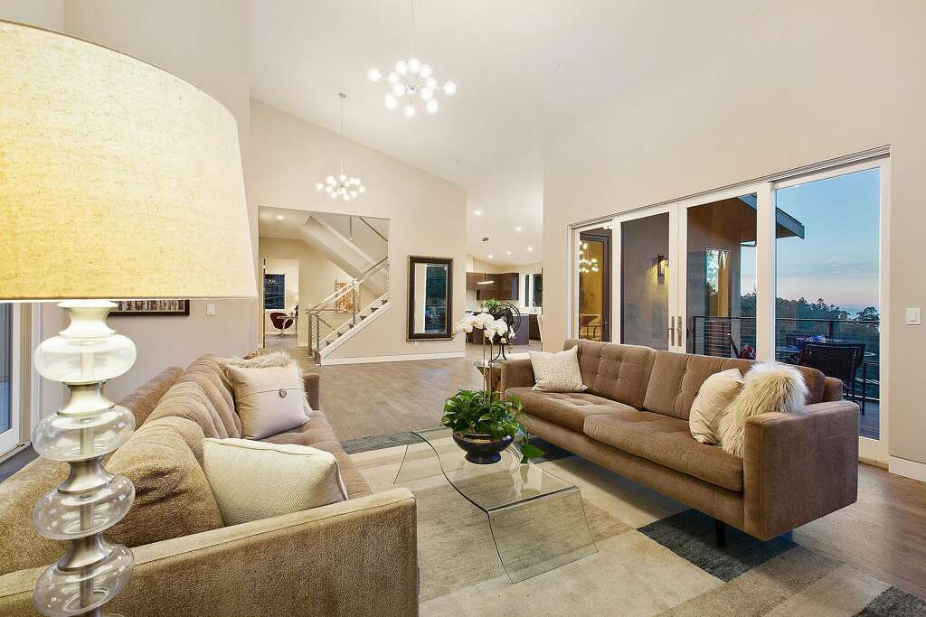 French Doors Off The Living Room Open To A Spacious View Deck Photo