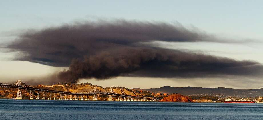 Fire at the Chevron Refinery in Richmond, as seen from Tiburon, on August 6th, 2012. On Thursday, California regulators approved new refinery safety regulations inspired in part by the Chevron fire. Photo: John Storey, Special To The Chronicle