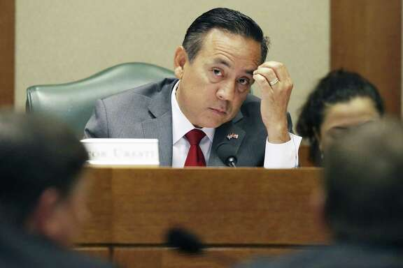 State Sen. Carlos Uresti, is fighting to keep out certain information from his criminal fraud trial, including a Securities and Exchange Commission investigation into the collapse of a San Antonio frac-sand company. Ureseti had multiple roles with the company. Uresti is pictured at the Texas Capitol in May.
