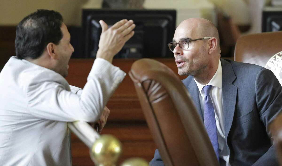 State Rep. Dennis Bonnen, R-Angleton, (right) discusses issues with Rep. Poncho Nevarez, D-Eagle Pass, as property tax legislation is considered on the floor of the House in May. On Thursday, Bonnen's committee approved a controversial property tax rollback bill that is now headed to the House, where its chances of passing are much higher than they were during the regular session.