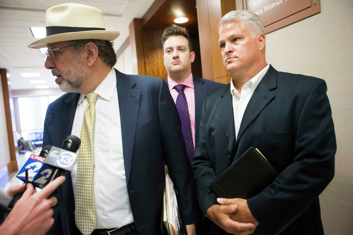 Stanley Schneider, left, tells the local press that the Harris County District Attorney's office has asked for a special prosecutor to decided whether to re-try his client David Temple, right, Friday, May 5, 2017, in Houston. ( Marie D. De Jesus / Houston Chronicle )