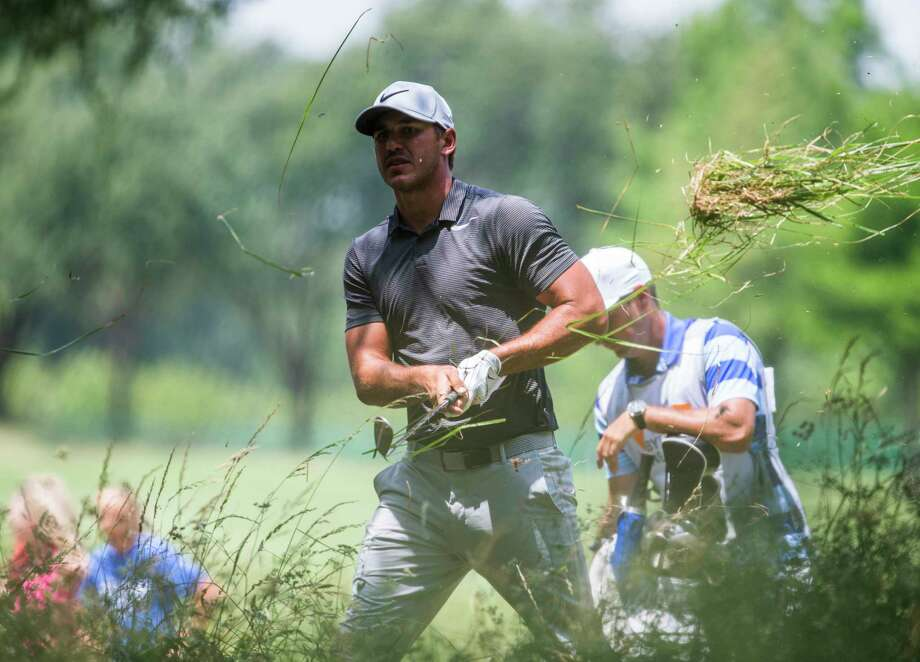 Brooks Koepka hits a ball out of the rough on the ninth hole during the first round of the Byron Nelson PGA golf tournament at TPC Four Seasons Resort in Irving, Texas, Thursday. Photo: Ashley Landis, MBR / The Dallas Morning News