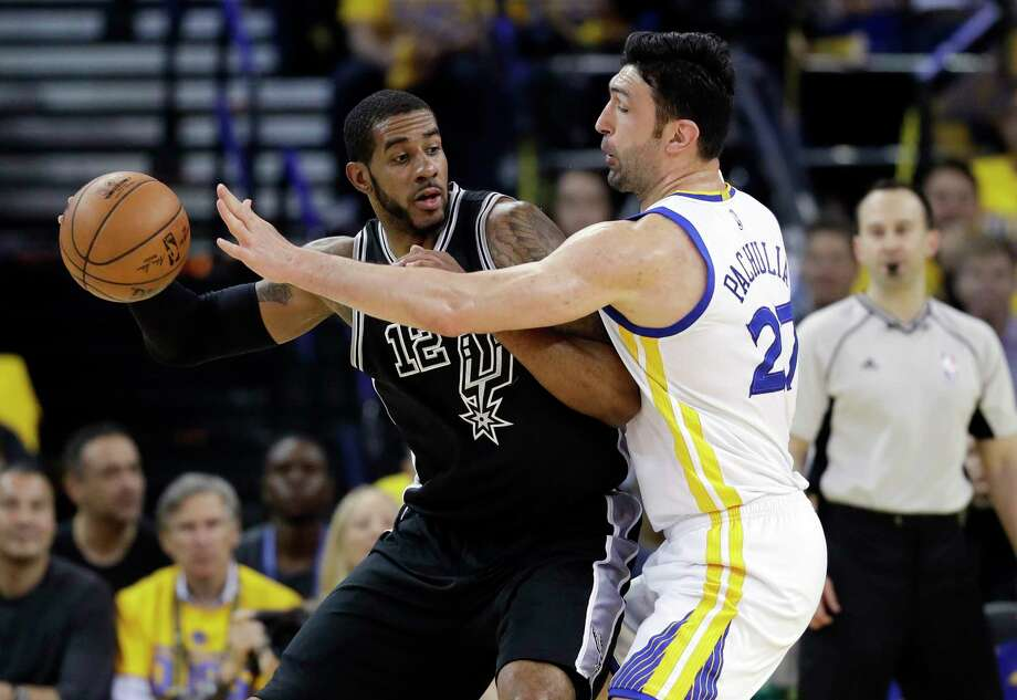 With the Warriors keying on him defensively, LaMar-cus Aldridge, left, scored eight points in Game 2. Photo: Marcio Jose Sanchez, STF / Copyright 2017 The Associated Press. All rights reserved.