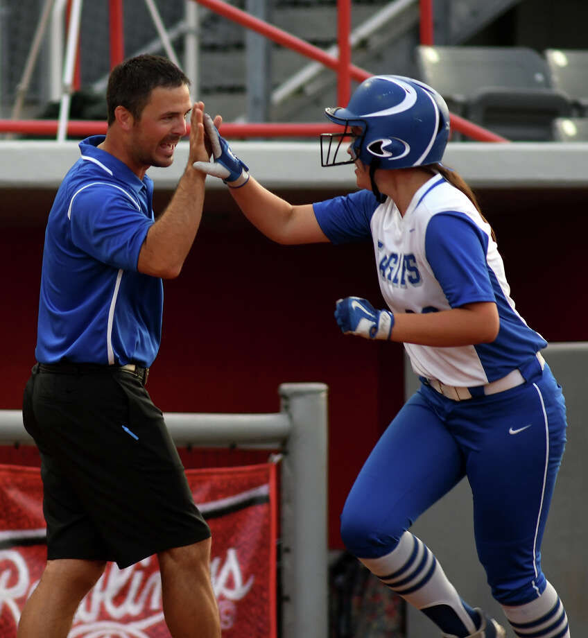 Barbers Hill's Rebecca Miller, right, gets a high-five from Lady Eagles head coach Aaron Fuller as she rounds third base after her two-run homerun against Brenham in the bottom of the third inning of game 1 of a best-of-three series in their Region III-5A Semifinal Softball Playoff at Cougar Softball Stadium on the campus of the University of Houston on Thursday, May 18, 2017. (Photo by Jerry Baker/Freelance) Photo: Jerry Baker/For The Chronicle