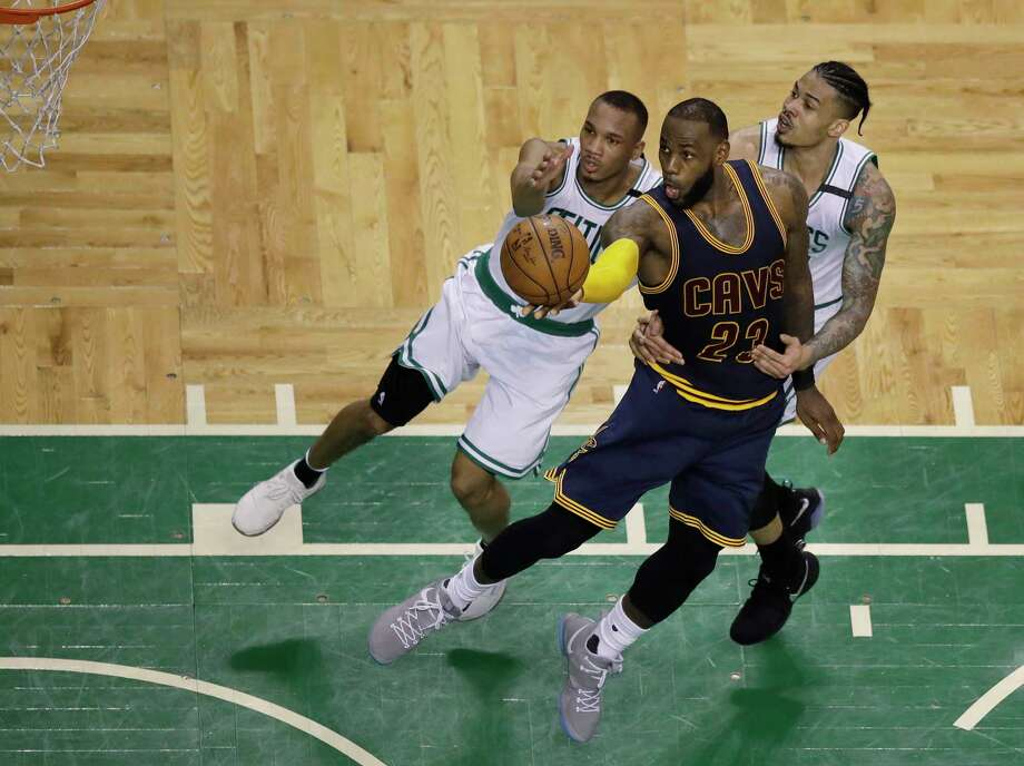 No matter what the Celtics tried against LeBron James, center, in Wednesday's Game 1, it didn't work as the Cavaliers star scored 38 points. Photo: Charles Krupa, STF / Copyright 2017 The Associated Press. All rights reserved.