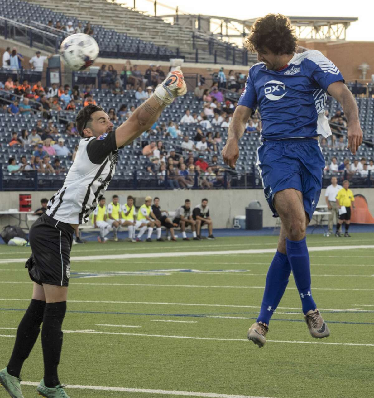 Midland-Odessa FC's Ricardo Palomino attempts to head the ball past Houston Regals' goalkeeper, Gonzalo Santa 5/18/17 in the season opener at Grande Communications Stadium. Tim Fischer/Reporter-Telegram