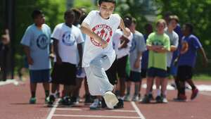 Wamedh Othman, 11, of Phillip Schuyler Elementary School competes in the long jump at the annual Albany Police Athletic League (PAL), Elementary School Track Meet at Albany High School on Thursday, May 18, 2017, in Albany, N.Y.  The event brought  together more than 250 fifth and sixth grade students from AlbanyOs public, private, parochial and charter schools to compete in various track and field events.  (Paul Buckowski / Times Union)