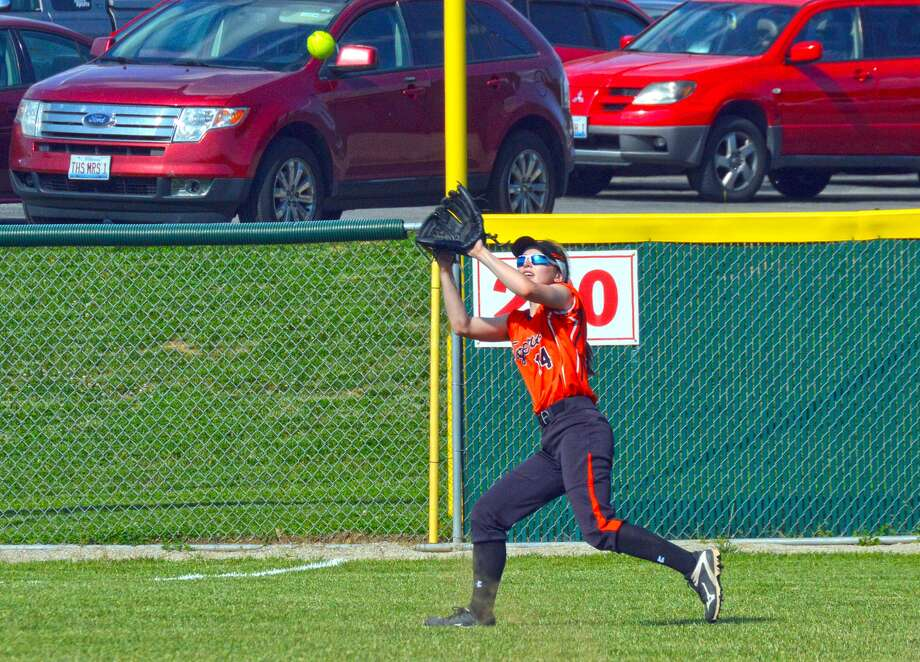 Edwardsville left fielder Lauren Taplin prepares to make a catch during Thursday's Southwestern Conference game against the Alton Redbirds in Alton.