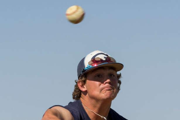 Greenwood pitcher Dawson Merryman gets in some throws 5/18/17 during practice. Tim Fischer/Reporter-Telegram