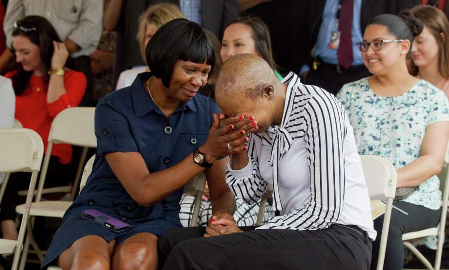 U.S. Army Sergeant First Class Demitra Jarrett, right, is comforted by her mother Gloria after being awarded new custom, mortgage-free home through Operation Finally, an organization that supplies homes to veterans and their families, in the Woodforest subdivision, Thursday, May 18, 2017, in Montgomery. Demitra suffered a traumatic brain injury while serving in Iraq in 2003. Photo: Jason Fochtman, Staff Photographer / © 2017 Houston Chronicle