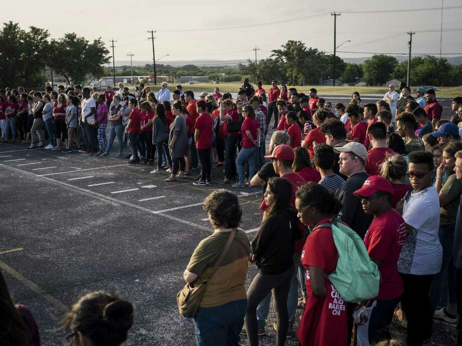 Taft High School students, faculty, alumni and friends gather during a vigil Thursday for the principal, Tommy Garcia, who died at 56 years old after a short illness. Photo: Matthew Busch /For The San Antonio Express-News / © Matthew Busch