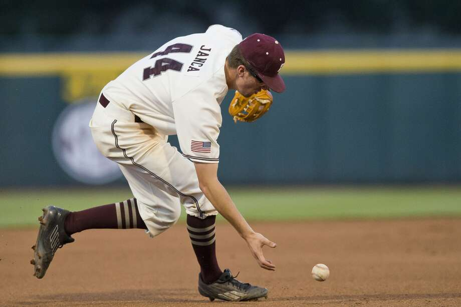 Texas A&M third baseman George Janca (44) scoops up a grounder by Arkansas outfielder Luke Bonfield (17) Thursday, May 18, 2017, at Olsen Field in College Station, Texas. Photo: Timothy Hurst/The Bryan-College Station Eagle