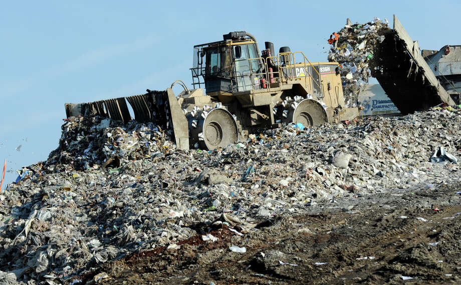 Heavy machines moves waste at the Rapp Road Landfill on June18, 2010,  in Albany, N.Y. (Skip Dickstein/Times Union) Photo: Skip Dickstein / 00009189A