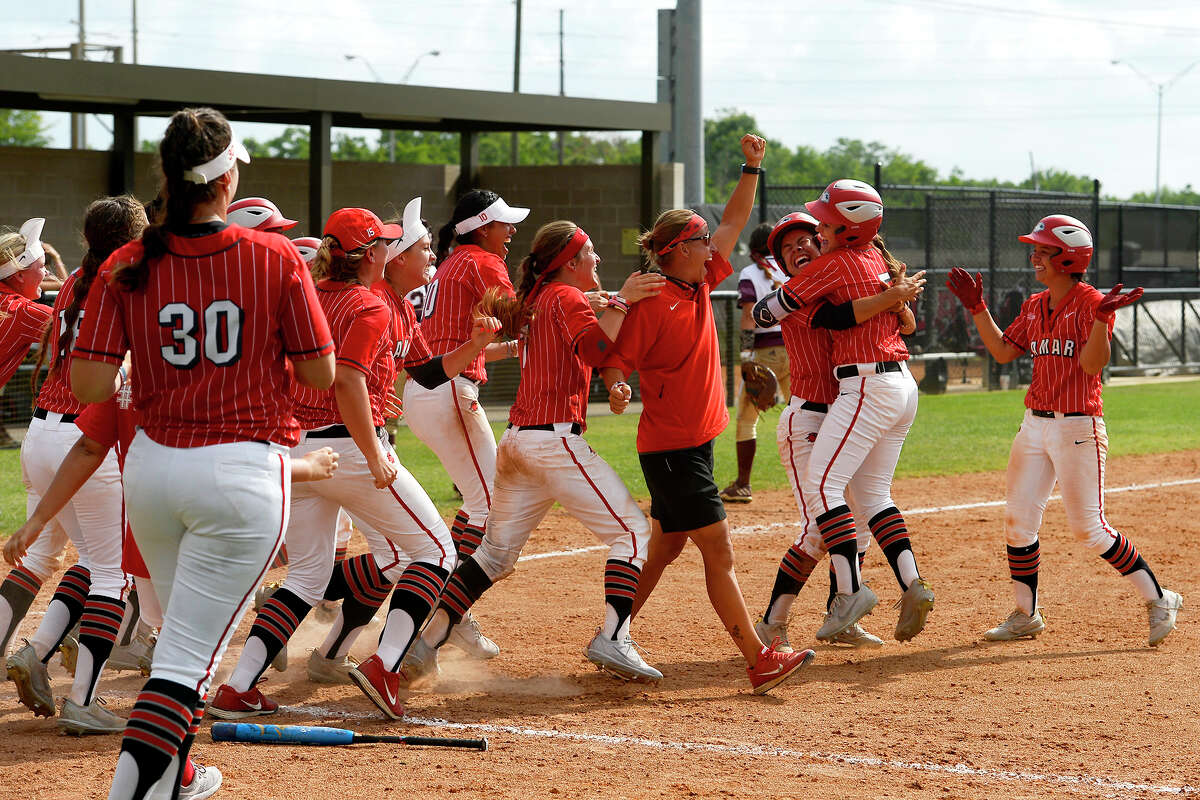 Lamar softball coach Holly Bruder celebrates with her players after they beat Louisiana-Monroe in the National Invitational Softball Championship tournament regional championship game at the Lamar Softball Complex on Thursday afternoon. Photo taken Thursday 5/18/17 Ryan Pelham/The Enterprise