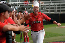 Lamar softball's Ashley McDowell cheers on the team in the seventh inning against Louisiana-Monroe in the National Invitational Softball Championship tournament regional championship game at the Lamar Softball Complex on Thursday afternoon. The Cardinals won 3-2 on a walk-off RBI.  Photo taken Thursday 5/18/17 Ryan Pelham/The Enterprise