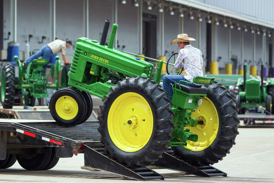 Colin Graff loads a tractor onto a trailer for their trip home to Hondo, Texas after competing in Agricultural Mechanics competition on the final day of the Houston Livestock Show and Rodeo on Sunday, March 18, 2012, in Houston. Photo: Smiley N. Pool, Houston Chronicle / © 2012  Houston Chronicle