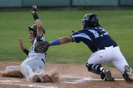 Ramon Garza of Reagan is tagged out by Johnson catcher Dominic Tamez during Game 1 of their Class 6A third-round series on Thursday, May 18, 2017.