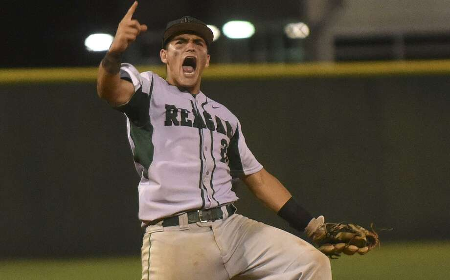 Reagan shortstop Ramon Garza celebrates after catching the final out in a 7-2 win over Johnson in Game 1 of the Class 6A third-round playoff series on May 18, 2017. Photo: Billy Calzada /San Antonio Express-News / Billy Calzada