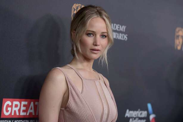 FILE - In this Oct. 28, 2016, file photo, Jennifer Lawrence arrives at the BAFTA Los Angeles Britannia Awards at the Beverly Hilton Hotel in Beverly Hills, Calif. Lawrence acknowledged on May 17, 2017, that a tabloid site's video of her dancing on a stripper pole is the real thing, but the actress says she's not sorry about it. (Photo by Richard Shotwell/Invision/AP, File) ORG XMIT: PAPM102