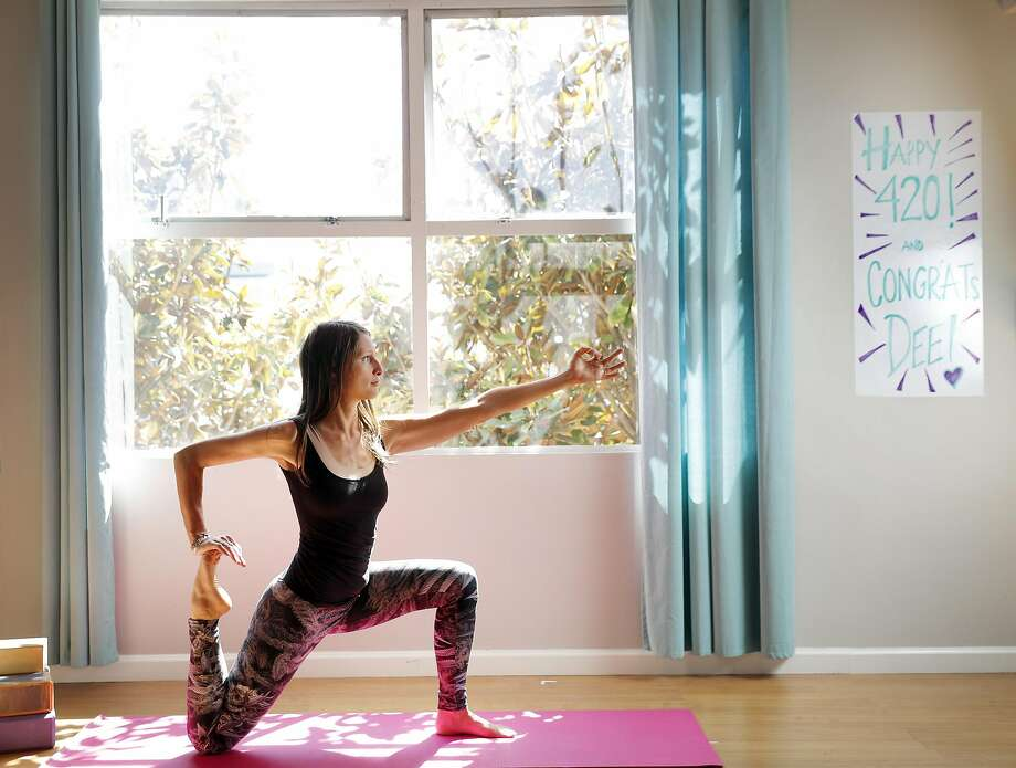 Dee Dassault, creator of Ganja Yoga, demonstrates a yoga pose in a studio she uses for her classes in San Francisco, Calif., on Thursday, May 18, 2017. Photo: Carlos Avila Gonzalez, The Chronicle