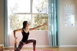 Dee Dassault, creator of Ganja Yoga, demonstrates a yoga pose in a studio she uses for her classes in San Francisco, Calif., on Thursday, May 18, 2017.