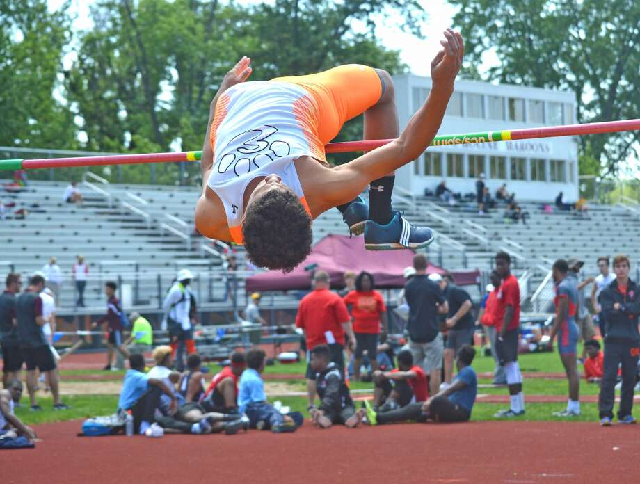 Edwardsville senior Justin White clears 6-3 in the high jump on the way to qualifying for the Class 3A state meet during Thursday's Moline Sectional.