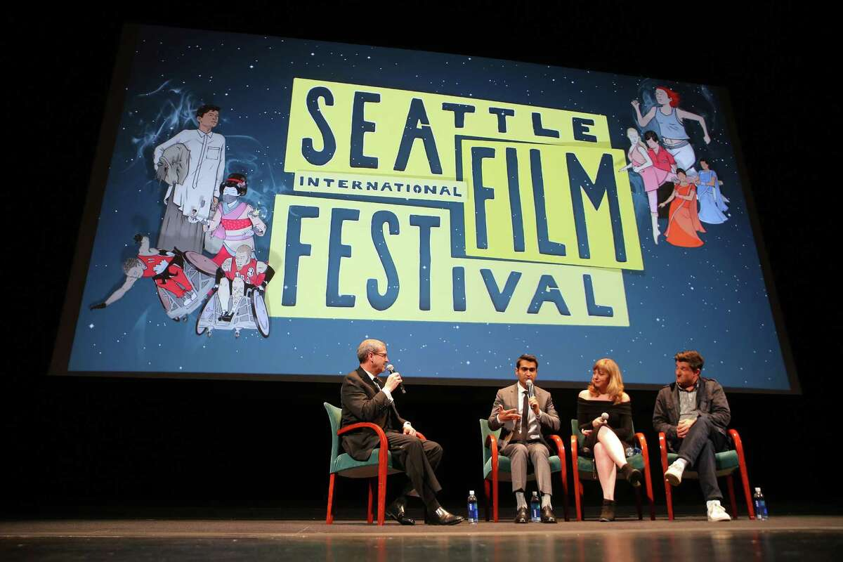 """FILE-- Co-writer/actor Kumail Nanjiani, his wife co-writer Emily Gordon and director Michael Showalter answer questions after a screening of their film """"The Big Sick"""" during the opening night gala of the Seattle International Film Festival on Thursday, May 18, 2017 at McCaw Hall in Seattle. Click ahead to see the big names for SIFF 2018 films."""