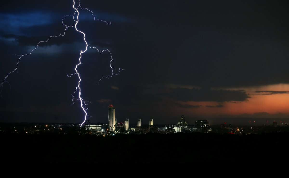 Lightning lights up the sky over Albany Thursday night. Powerful storms struck the area during the last afternoon and evening, leaving thousands of National Grid customers without power.