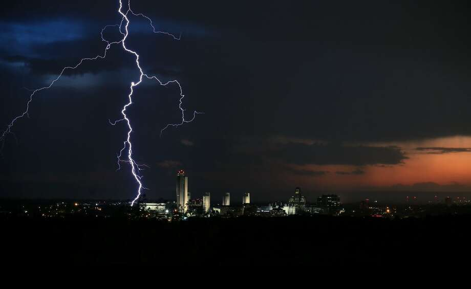 Lightning lights up the sky over Albany Thursday night. Powerful storms struck the area during the last afternoon and evening, leaving thousands of National Grid customers without power. Photo: Ray Diaz / Special To The Times Union