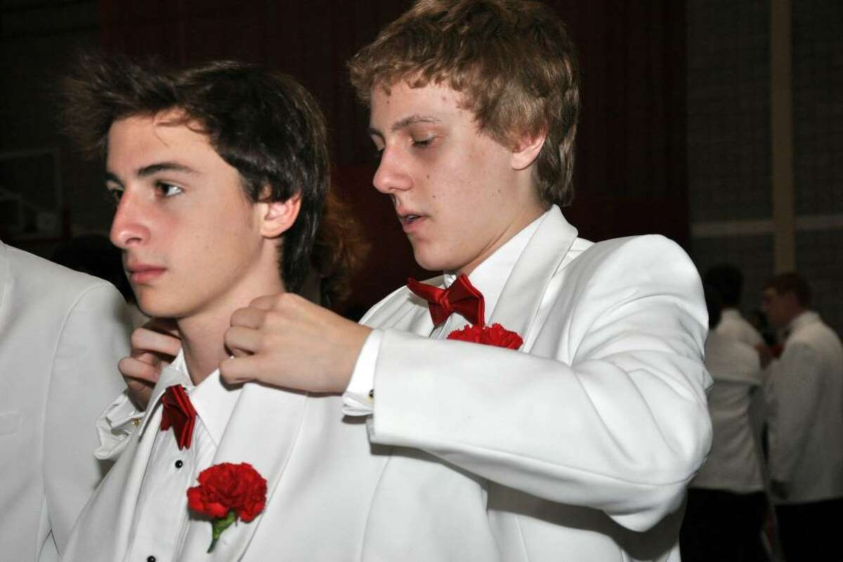Charlie Scofield, of Stratford helps classmate John Stiller, of Trumbull, with his bow tie before Fairfield College Preparatory School's 68th Commencement ceremony on Sunday, June 6, 2010.