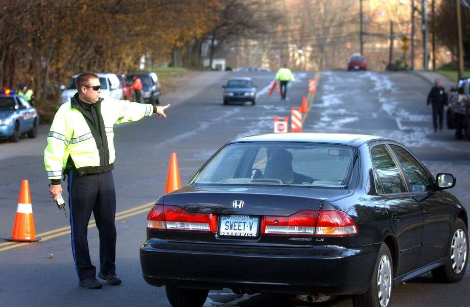 Stamford Police set up a check point to do safety belt inspections on Roxbury Road in Stamford. The 2017 seat belt enforcement campaign begins on May 22 and continues to June 4. Photo: / ST